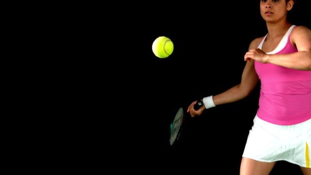 Tennis player hitting the ball video