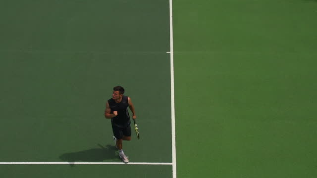 A Tennis Player Serves and Celebrates Serving an Ace. video