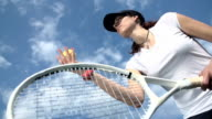 Tennis player serving the ball low angle slow motion video