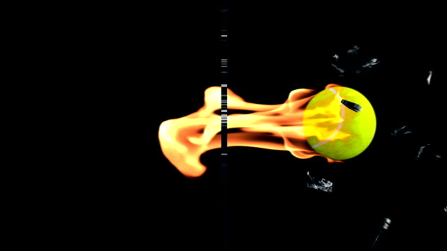 Tennis-Ball on fire breaking glass, side view video
