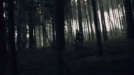 Terrified young woman running through the forest video