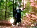 Terrifying witch doing magic tricks in dark forest video