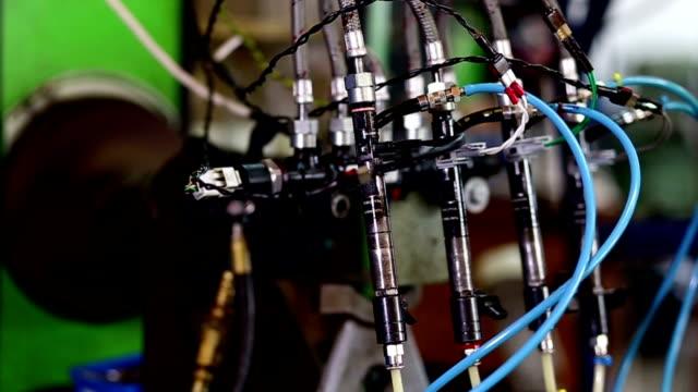 Testing diesel injector in his workshop video