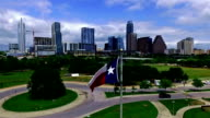 Texas Flag Flying in front of the Texas Capital City of Austin , TX Skyline Cityscape video