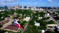 Texas Flag Iconic Austin Texas View with Skyline Cityscape Capitol Building Background video