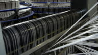 Textile industry - yarn spools on spinning machine in a factory video