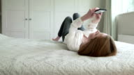 Texting laying on bed       LI CM video
