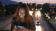 Texting on the cell phone and smiling video