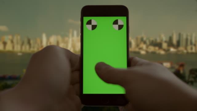 Texting surfing New York City chromakey green screen smart phone video