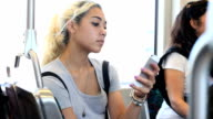Texting teen prepares to get off train video