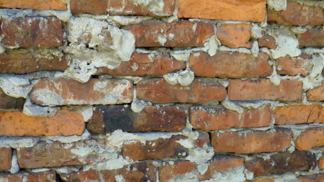 Texture of old red brick wall background video
