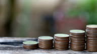 Thai baht coins stacked of bar chart in the concept of business investment. video