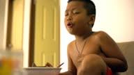 Thai boy overeats instant noodles video