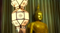 Thai buddhist temple various elements at dusk. Magic hour with blue sky and spotlight shine video