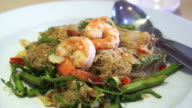 Thai Chinese fusion cuisine, stir fried noodle with vegetable and shrimp video