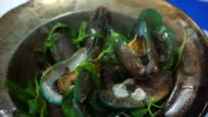 Thai, Chinese seafood baked mussels in the pot with herb video