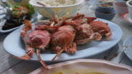 Thai Chinese style seafood. Steamed blue crab and crab meat in curry power video