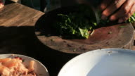 Thai Cooking on wooden chopping board video