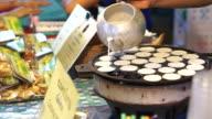 Thai dessert , Coconut milk pancake, mix with flour rice cake. Chef cooking Khanom Krok video