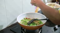 Thai food, Cooking pour sugar on vegetables and mussel in a wok video
