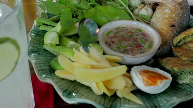 Thai Food Nam Prik Set, Shrimp Paste Chilli Sauce set with Vegetables and shortbodied mackerel fish video