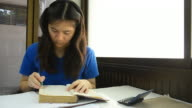Thai girl student highlight note on old book video