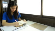 Thai girl student short note on notebook. video