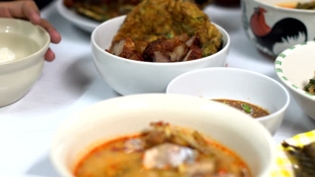 Thai local food with rice on table video