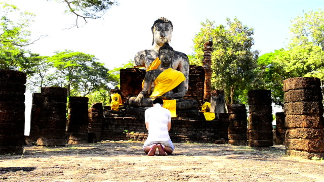 Thai people and Old Stone Buddha Statues video