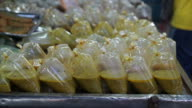 Thai street food vendor in Thailand, selling ready made food in a plastic bag video