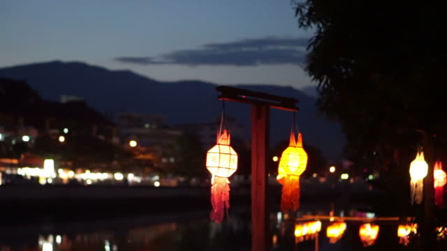 Thai style Lanna flag and Paper lanterns decorated by the river in Yee-peng festival ,ChiangMai Thailand video