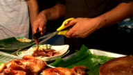 Thai style Street food grilled chicken or BBQ with charcoal ,Thailand video