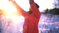 Thai Woman playing with snow slowmotion video
