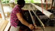 Thai woman weaving at home in Chaiyaphum, Thailand. video