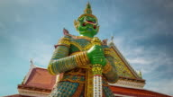 thailand day famous wat arun bangkok temple demon guardian 4k time lapse video