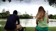 Thailand Holiday. Couple kissing in City Park Bangkok video