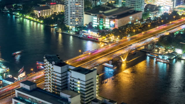 thailand night light bangkok traffic river bridge metro station hotel roof top view 4k time lapse video