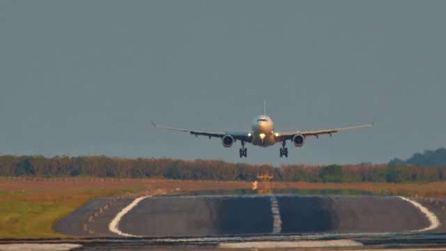 thailand phuket island main airport sunset sunrise jet plain landing hd video