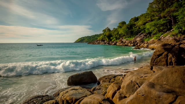 thailand summer day freedom beach two men swimming in waves hd phuket video