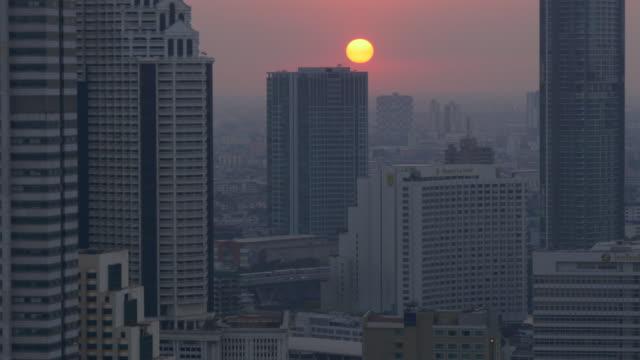 thailand sunset night twilight silom city centre block roof top panorama 4k bangkok video