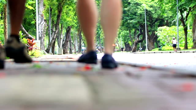 Thailand Video. Couple walking in City Park Lumphini Bangkok video