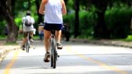 Thailand Video. Cyclist in City Park. Bangkok Lumphini Slow Motion video