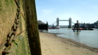 Thames foreshore with zoom in to Tower Bridge. video