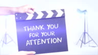 Thank you for your attention film slate in a studio shot background video