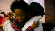 Thankful African American Girl Hugging Mom on Christmas Morning video