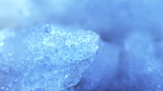 thawing blue ice close-up timelapse video