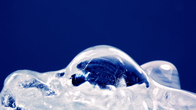 thawing ice close-up timelapse video