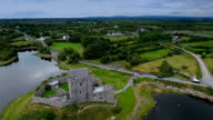 The aerial shot of the historic Dunguaire castle video