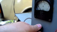 The ammeter measures the voltage across the battery car. Charging. video