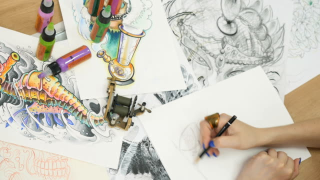 The artist draws sketches for tattoo video